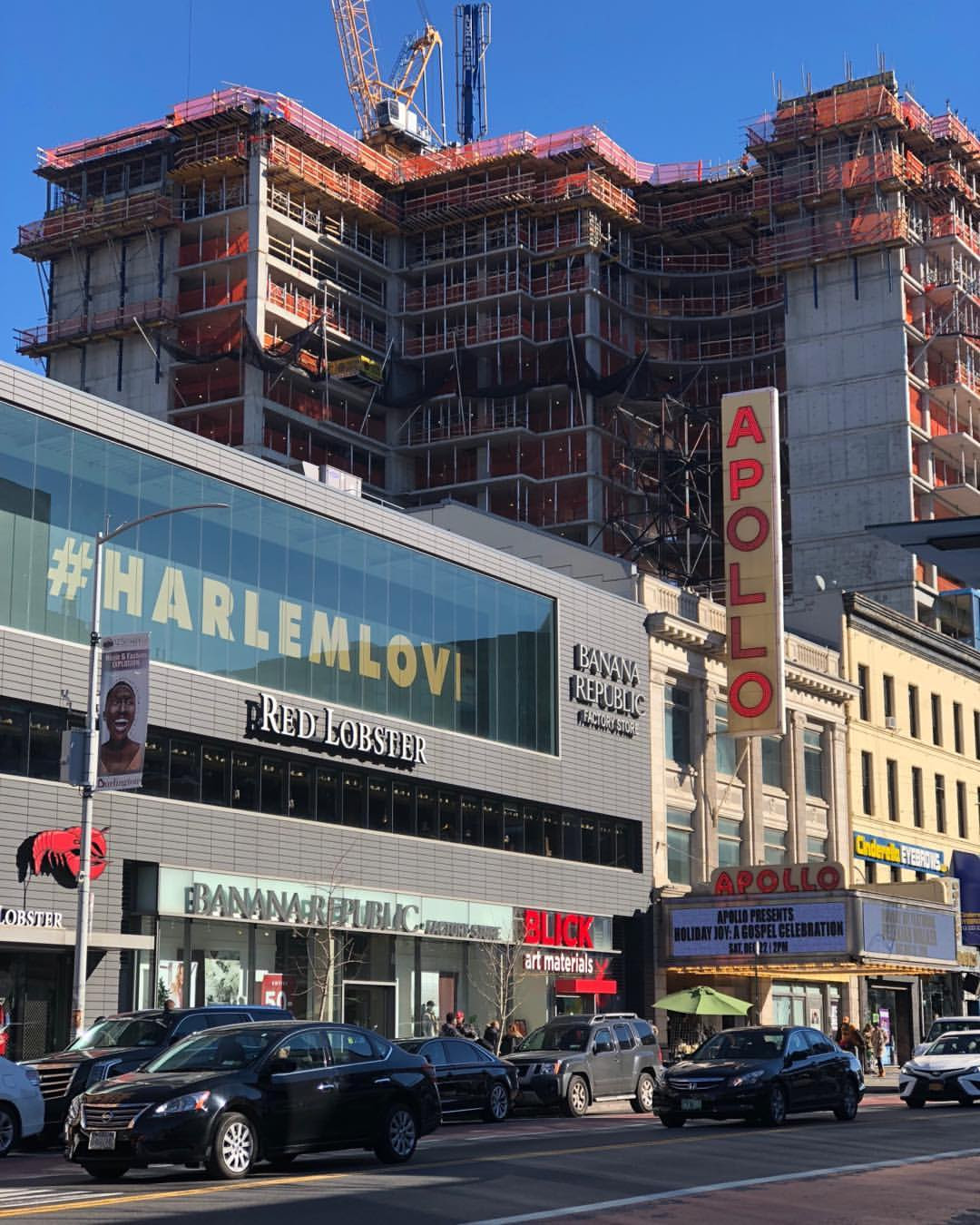 The Apollo Theater standing amongst the giants who are trying to swallow her. Is it truly #HARLEMLOVE